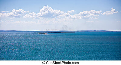 Black and Azov Sea in Crimea, sand spit in the sea