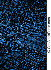 Black and blue fabric with flower pattern as background