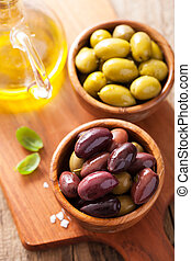 black and green marinated olives in bowls