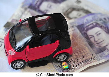 Black and red car over a lot of British Pound Sterling bills...