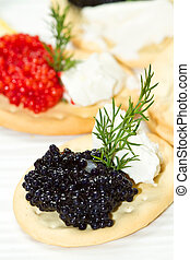 black and red caviar canape