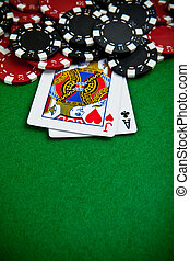 Black and red poker chips in the background.