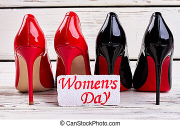 Black and red women's shoes.