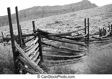 black and white abandoned corral - old corral in the desert