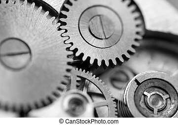 Black and white background with metal cogwheels a clockwork....
