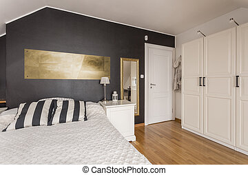 Black and white bedroom with gold accents