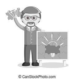 black and white businessman holding puzzle idea
