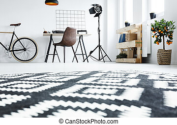 Black and white carpet in room