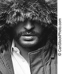 Black and white close up portrait of criminal man