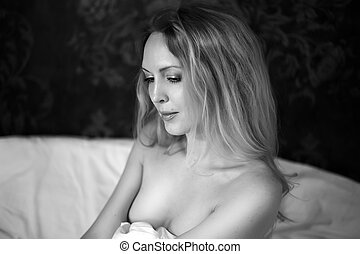 Black and white close up portrait of beautiful blond woman