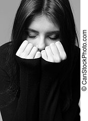 Black and white closeup portrait of a nervous woman