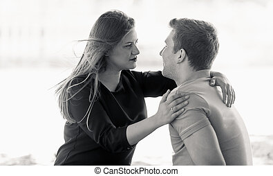 Black and white closeup portrait of beautiful couple looking at each other