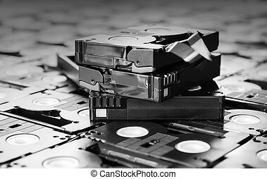 Black and white colour abandoned pile of old useless mini DV