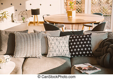 Awe Inspiring Navy Blue Cushions On A Gray Couch A Wicker Chair And Short Links Chair Design For Home Short Linksinfo