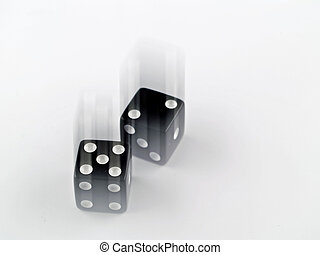 Black and white dice falling on a white background