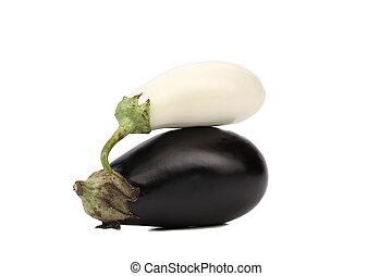 Black and white eggplants.