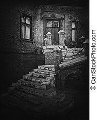 Black and white exterior architecture details, old staircase leads to the entry of the Hunting Castle at Manuc Bei mansion. Old brick building facade. Halloween haunted house concept, ghost home.