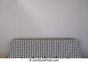 Black and white fabric sofa.
