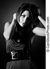 Black and White Image of a Beautiful Teenager Pulling her...
