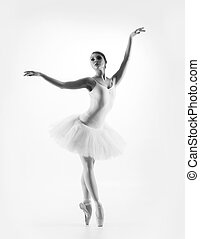 Black and white image of young beautiful ballet dancer isolated over white background