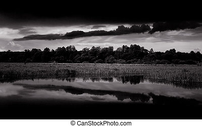 Black and White Landscape with Dark Clouds