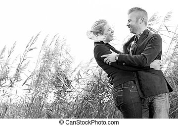 Black and white lovers - Happy young couple is having a nice...