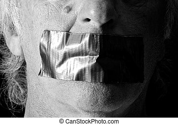 black and white mouth duct taped shut
