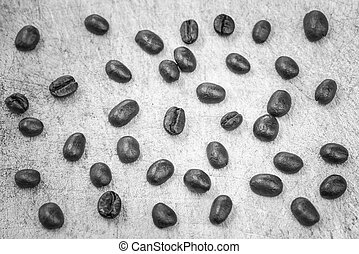 black and white of coffee beans on wooden background