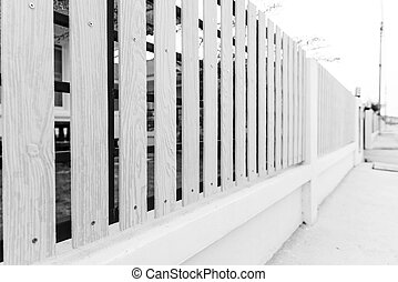 black and white of picket fence