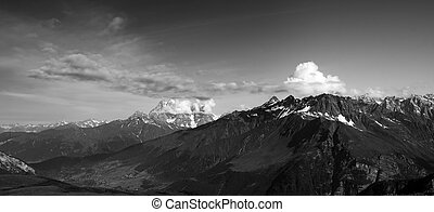 Black and white panorama of summer mountain