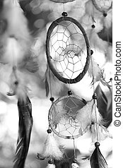 black and white photo of a dream catcher at sunset purple...