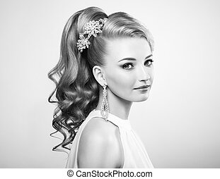 Black and white photo of beautiful woman with elegant hairstyle