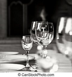 black and white photo of glass goblets on the table
