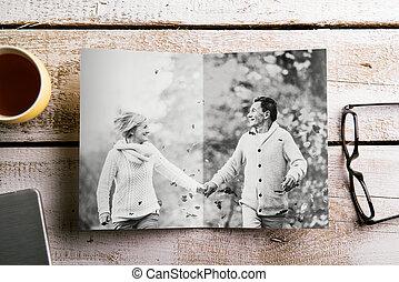 Black-and-white photo of senior couple in autumn nature, studio