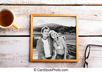 Black-and-white photo of seniors in picture frame. Studio shot.
