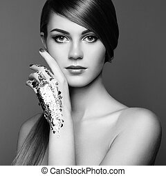 Black and white photo of woman with silver hands