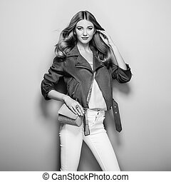 Black and white photo of young woman in leather jacket
