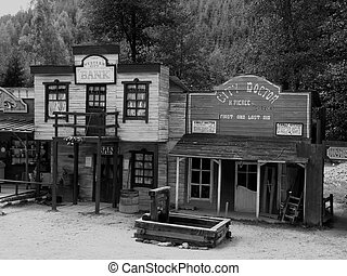 western village - black and white photograph of a western ...