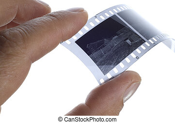 Black and white photographic film in hand