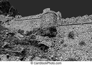 black and white photography of the castle of Monemvasia wall Greece