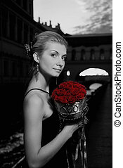 Black and white picture of a beautiful girl with roses in...
