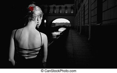 Black and white picture of a girl in old city
