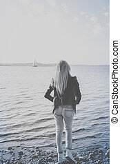 Black and white picture of blonde waiting on the beach - ...