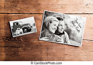 Black-and-white pictures of senior couple. Studio shot on wooden