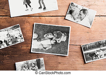 Black-and-white pictures of seniors. Studio shot, wooden background