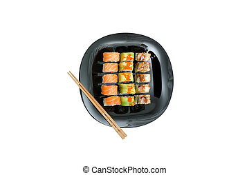 Black and white plate with various rolls and chopsticks.Food concept. Isolated. White background