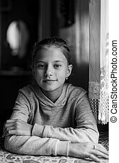 Black and white portrait cute teen girl in home.