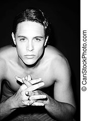 Black and white portrait of a beautiful shirtless male model