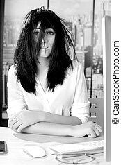 Black and white portrait of business woman with messy hair in office desperate