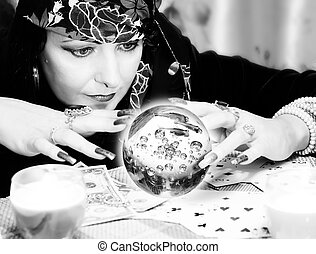 Black and white portrait of fortune-teller with chrystal...
